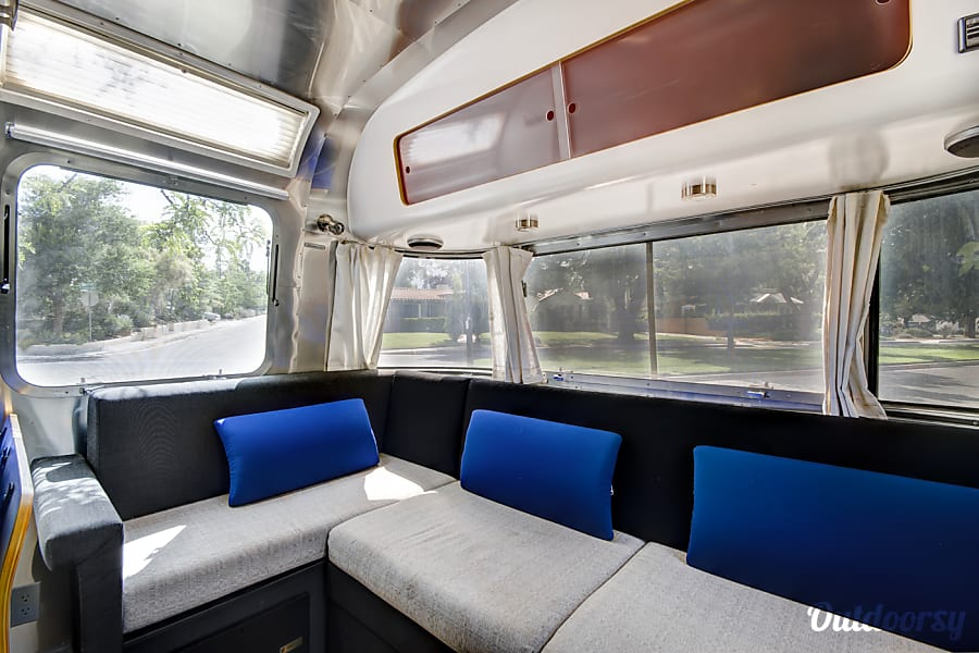 Airstream International Albuquerque, NM Overhead storage compartments above the front seating area, on both sides of the galley, and over the rear bed with tons of space.