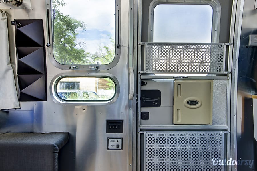 Airstream International Albuquerque, NM Push out windows with multiple opening settings; fully screened entry door.