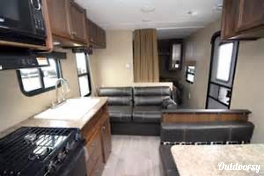2018 Coleman Lantern 274BH Colorado Springs, CO Jack knife sofa turns into a full size daybed.  The camper also features an on the wall thermoset that controls the in floor heating to keep you warm on those chilly nights.  Plus an overhead A/C unit that will keep you cool on those warm days.