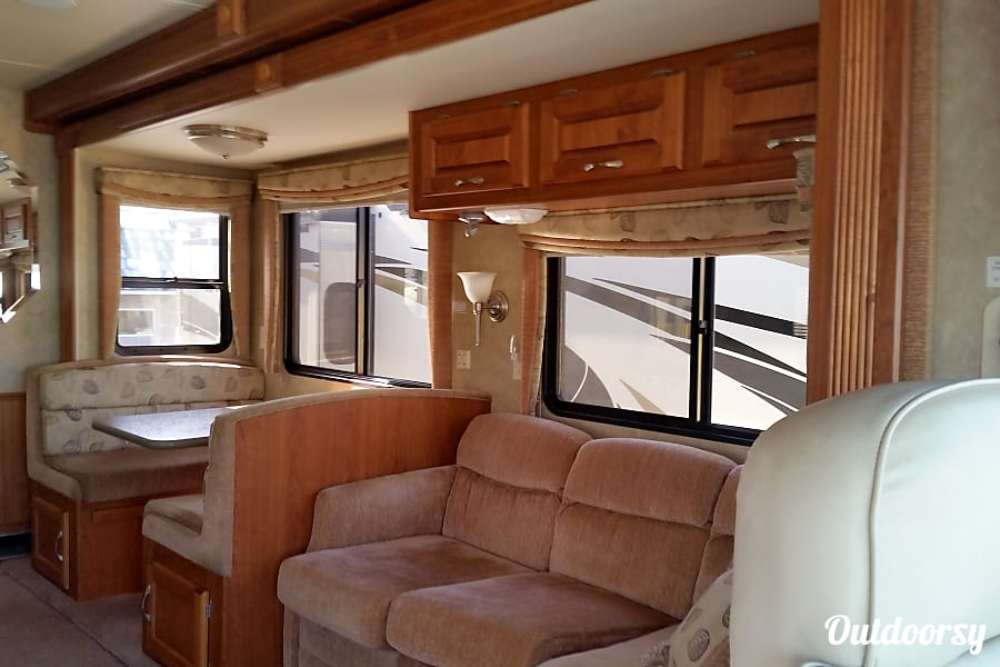 Luxury on wheels Las Vegas, Nevada Comfortable sofa and dining area, slide out gives lots of comfortable space