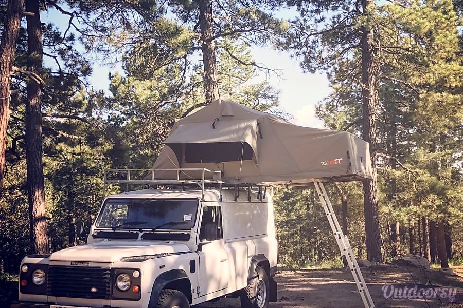 1991 Land Rover Defender 110 with a safari style roof top tent. Tucson, Arizona Camp anywhere and sleep in luxurious comfort on the california king size mattress.
