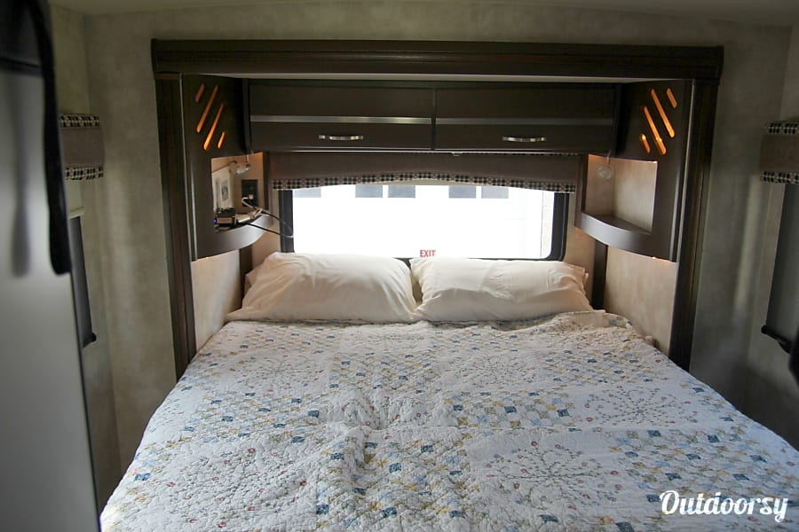 2011 Itasca Navion Huntsville, AL Bedroom with the slide out extended.  Very spacious and provides space to walk around the bed.