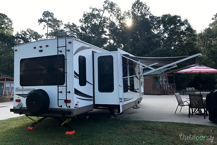 2016 Forest River Rockwood Windjammer 3029W Spring, TX View from the rear showing the dining room slide with awnings out