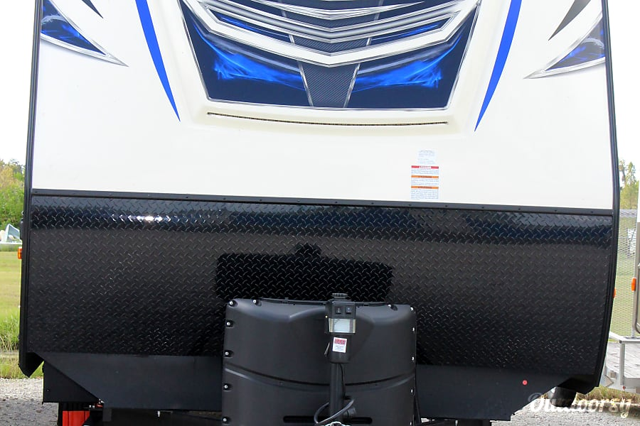 2018 Venture Rv Sporttrek Kissimmee, Florida Front exterior view. Electronic jack with light and two propane tanks under cover.