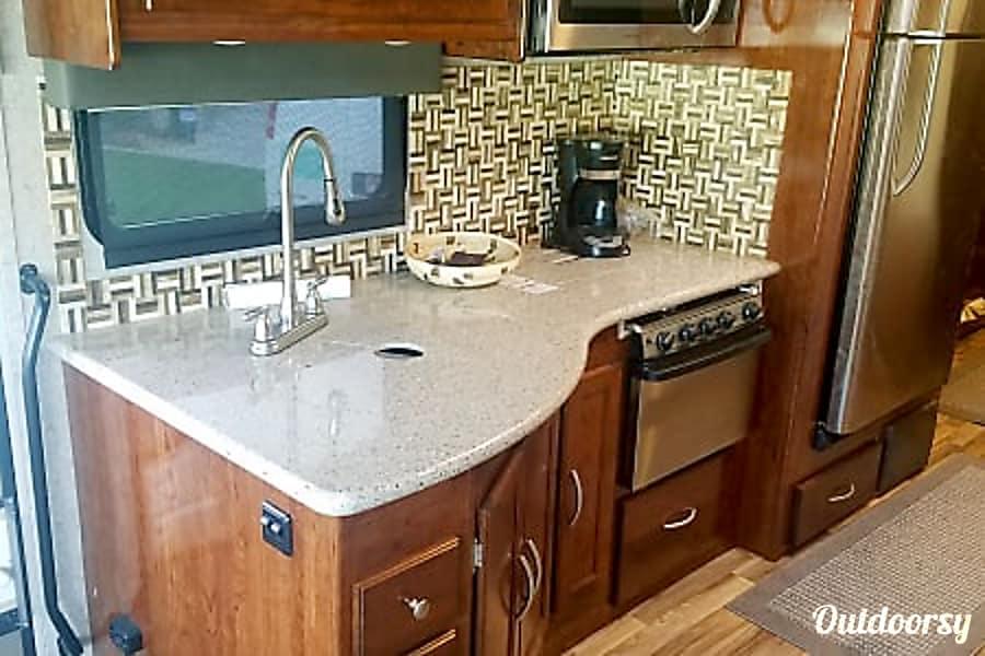 Beautiful 2017 Coachmen Mirada Layton, Utah Kitchen with stove and oven