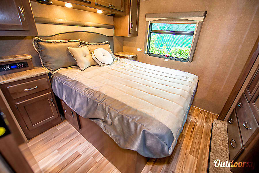 2017 Thor Motor Coach A.C.E Zionsville, IN Spacious master bedroom with Queen size bed, stereo and large TV. Plenty of storage and closet space for clothes.