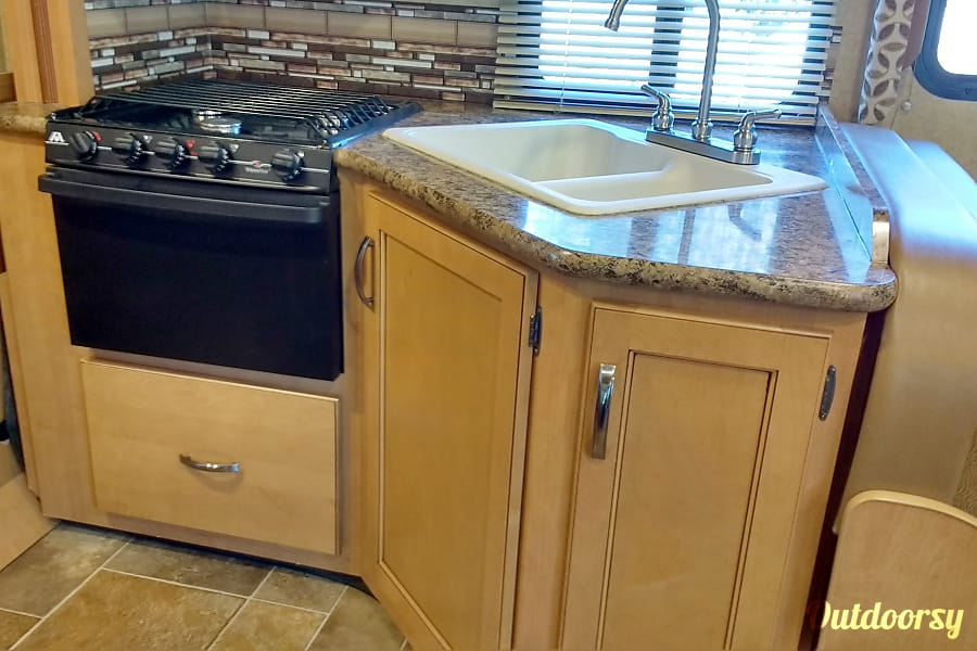 Contact owner for winter season availability Millcreek, Utah Compact, functional kitchen area; large drawer under oven for pots and pans.  Storage area under sink and utensil drawers also.  Overhead storage for dishes/food over sink area and sofa area.