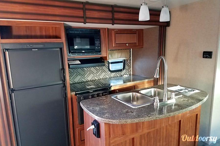 2017 M33 Mallard Ultralite by Heartland Penrose, Colorado Kitchen area with island.