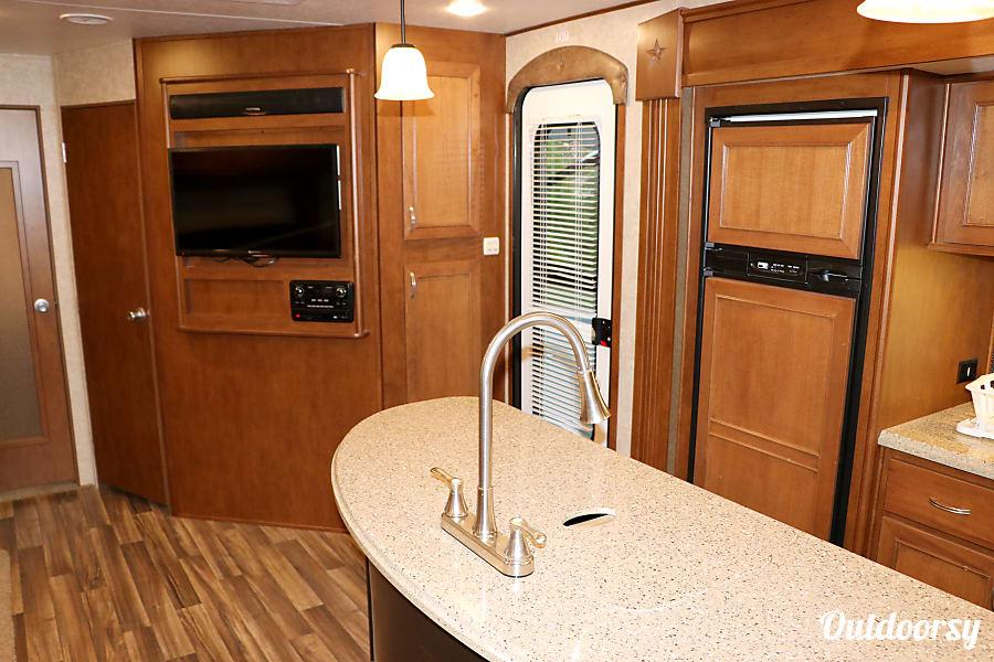 2017 Open Range Mesa Ridge 310BHS Maryville, Tennessee View from rear bedroom door back through kitchen toward entry door.