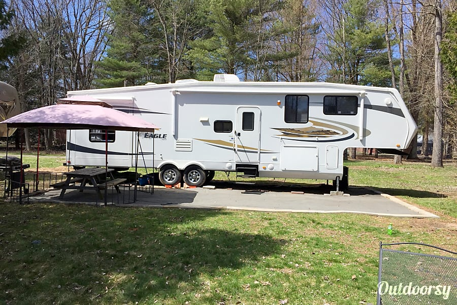 2010 Jayco Eagle Morris, New York This is our campsite all summer long.  The 4 slide outs aren't extended but you can see the unit well.