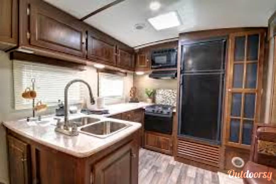Empty Nester's Dream! - 2017 Keystone Bullet Premier - 29RKPR Edmond, Oklahoma Kitchen with extra counter space you typically will not find in an RV. Great for meal prep. Fridge is operable on both gas and electric.
