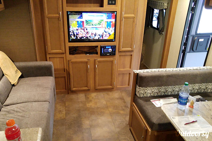2017 Coachmen Apex Macon, GA Living room with digital tv and couch