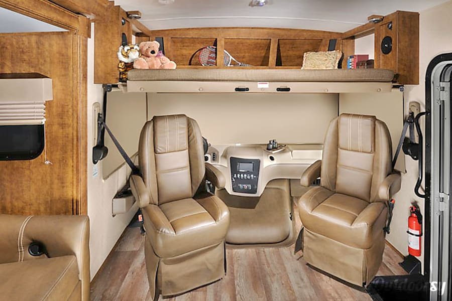 2018 Forest River FR3 30DS Breckenridge, CO Cockpit w/ privacy shades and seats turned toward living area. Includes overhead dropdown bed.