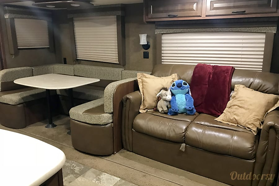 2015 Jayco Jay Flight Sahuarita, Arizona Table and couch can be converted into beds. The couch can fit two adults or three children. The table can fit up to three adults or four kids.