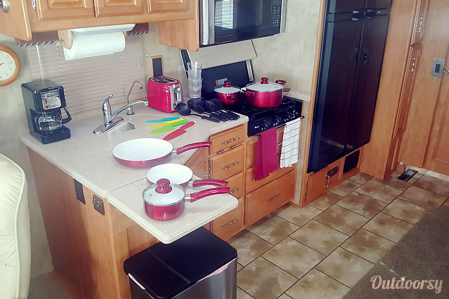 Luxury Winnabago Journey SE Like New Diesel Pusher Colorado Springs, Colorado Kitchen includes 3 burner stove, pots and pans, utensils, refrigerator, convection oven, water purifier, coffee maker, toaster, plates, cups, storage and space for food items