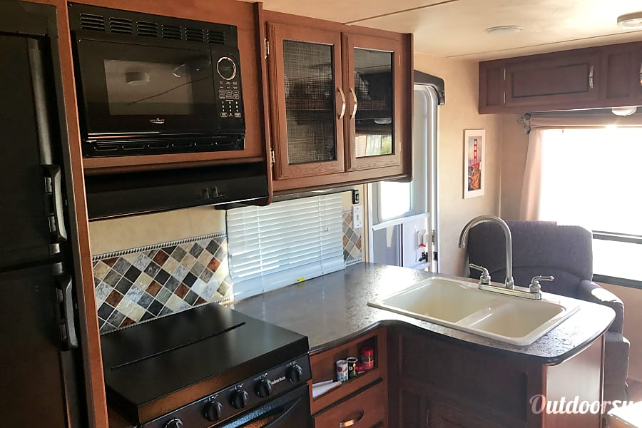 2016 Forest River Wildwood X-Lite Manteca, CA Kitchen comes full stocked with all dishes, utensils, cookware and a coffee pot.