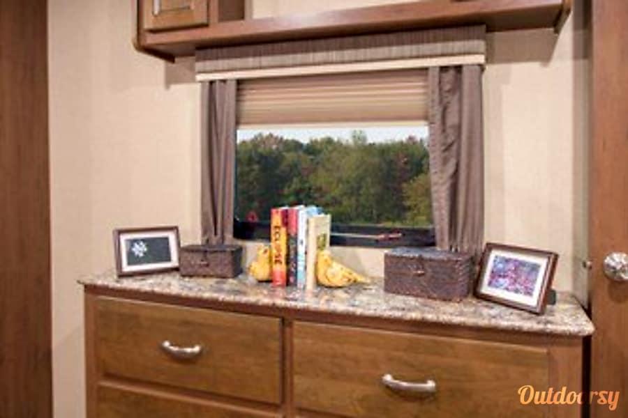 2016 Dutchmen Denali San Antonio, Texas Bedroom window with 6drawer dresser for all your clothing needs.