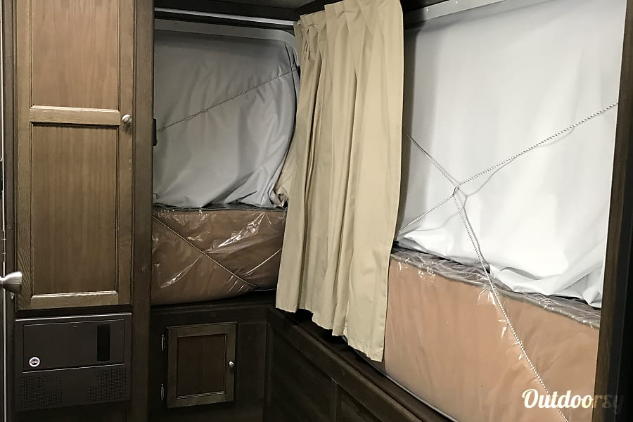 2018 keystone Bullet Crossfire 2190EX Fort Mitchell, Kentucky 2nd and 3rd Queen bunk ends folded up. Cabinet for storage.