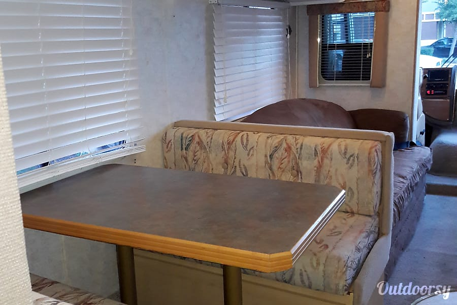 2000 Gulf Stream Palm Breeze San Antonio, Texas Eat in booth, has extra storage under seats and the table can extend for more table and it can be taken down and turned into third sleep area