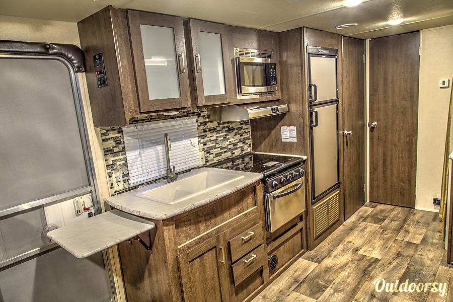 2018 Forest River Cruise Lite 230BHXL Corsicana, Texas Kitchen with lots of counter space and a huge pantry.