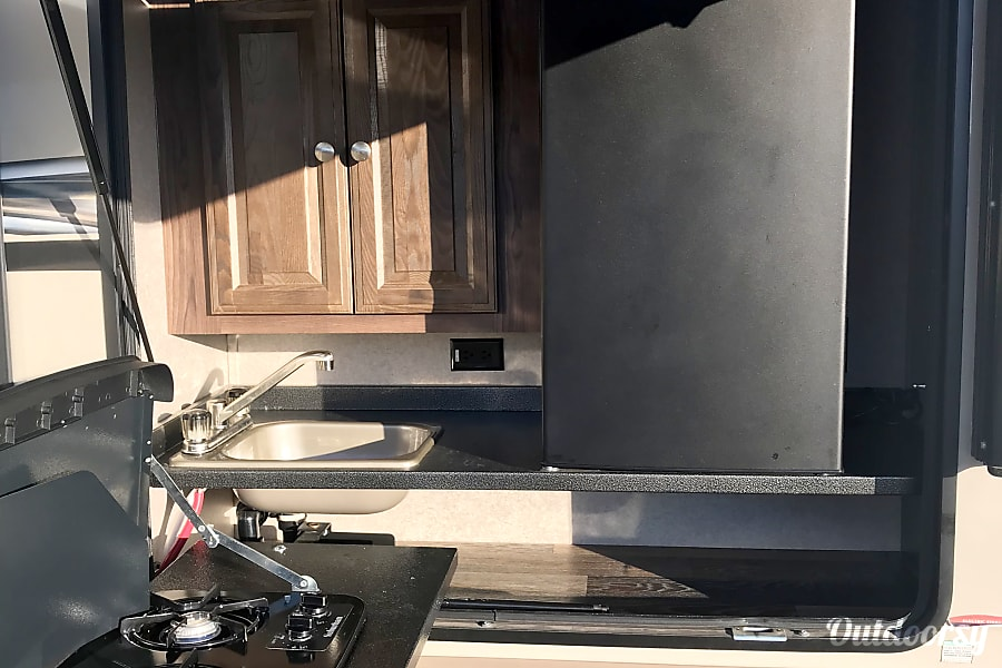 2017 Forest River V-Lite Lakehills, Texas Outdoor kitchen with stove top, refrigerator and sink.