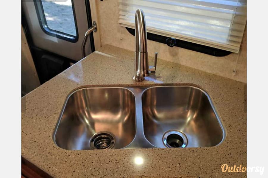 The GLAMPER call/text 443-462-6178. Westminster, MD Granite countertops, double sink with stainless steel pull down faucet.