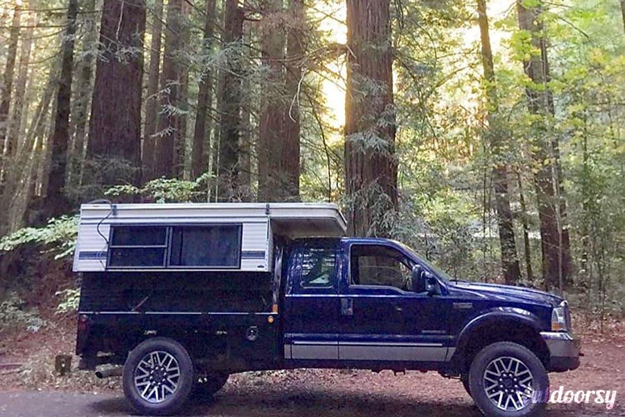 1996 Four Wheel Campers Grandby Motor Home Truck Camper Rental in Folsom, CA | Outdoorsy