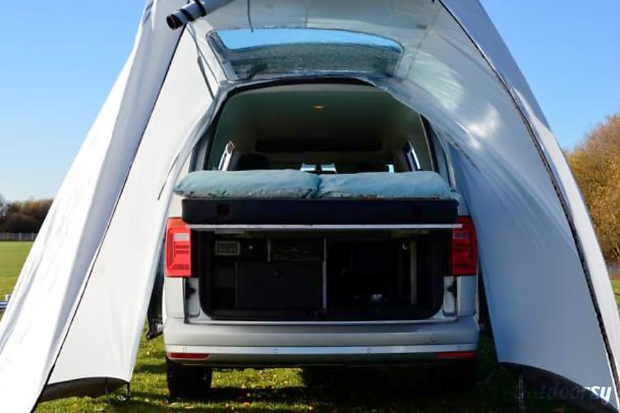 campervan rentals in London - Tent awning on the back of the blue VW Caddy Camper