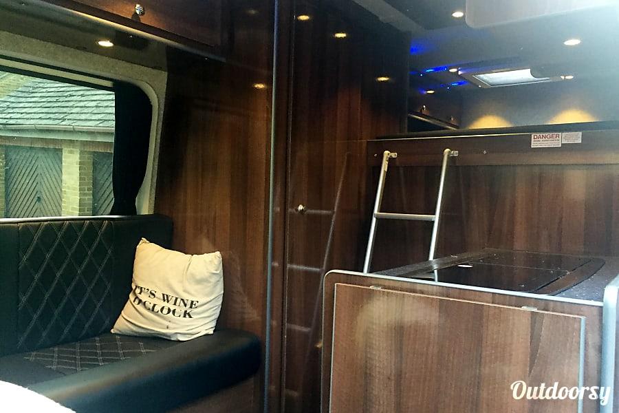 campervan rentals in London - ladder leading to raised sleeping area