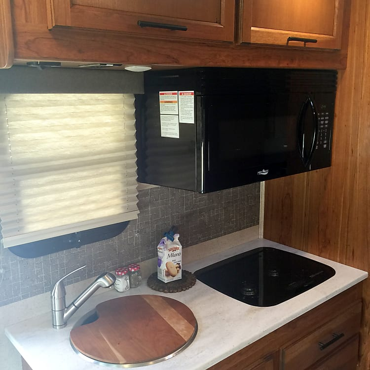 The surprisingly roomy kitchen with microwave/convection oven and two burner gas stove