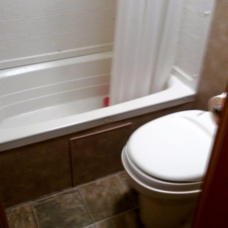 Bathroom has an unusual feature - a tub - imagine that!