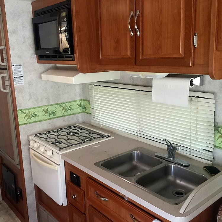 Great kitchen with refrigerator, freezer, microwave, propane stove / oven, and kitchen sink!