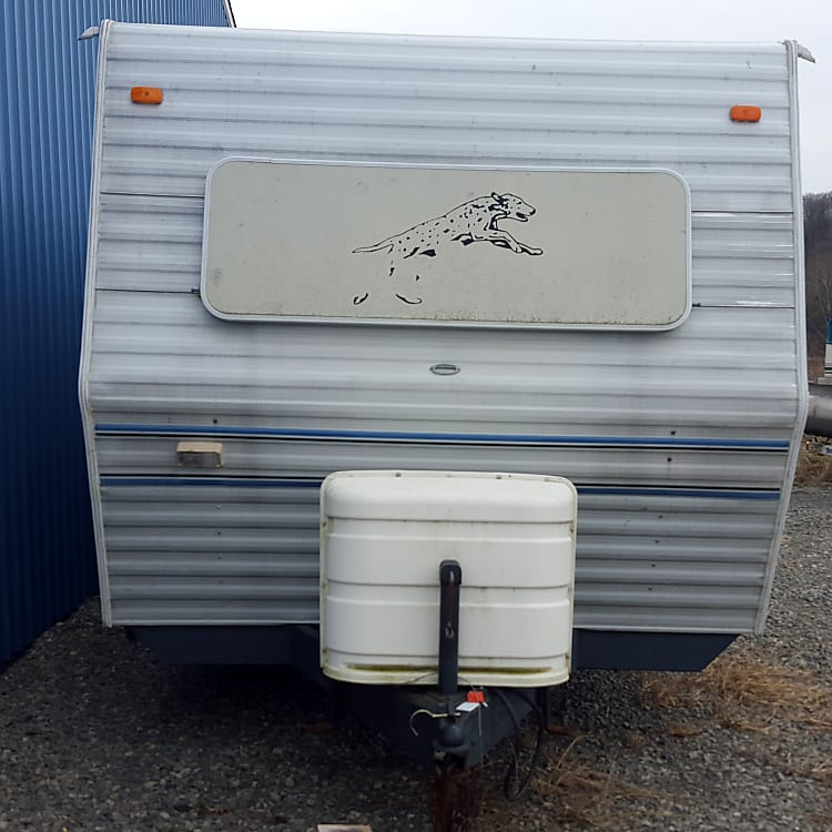 Front of camper.  Two 30# propane tanks.