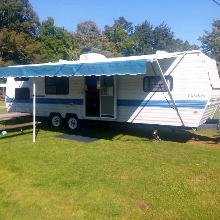 29 foot long camper.  (33 ft from tongue to tail).  Long newer awning gives lots of shade.