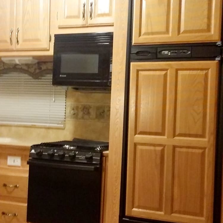 Stove and oven , microwave and fridge and freezer