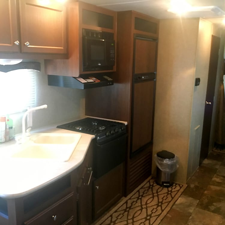 Full kitchen.  Double sink, microwave, fridge with separate freezer, three burner gas cooktop and gas oven.  Also have crockpot, toaster, coffee pot, griddle, and electric skillet.