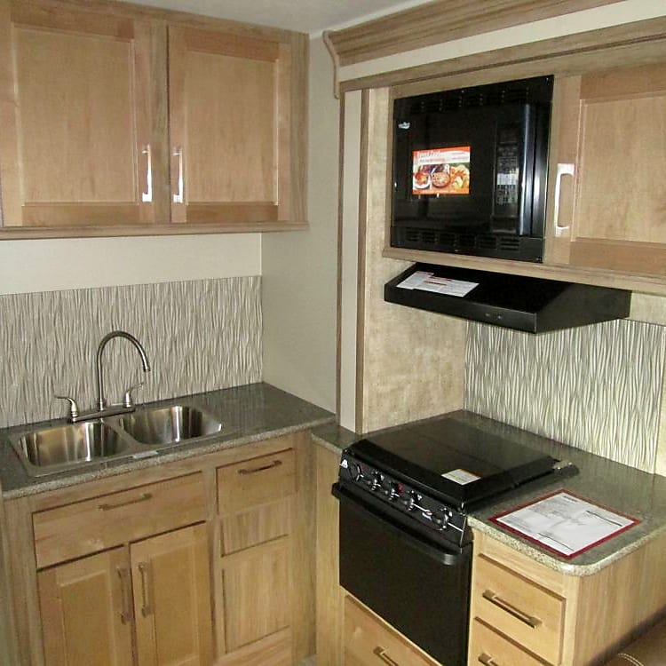 Full kitchen including 3 burner stove, oven, microwave and 2 compartment sink, with lots of cupboard space.