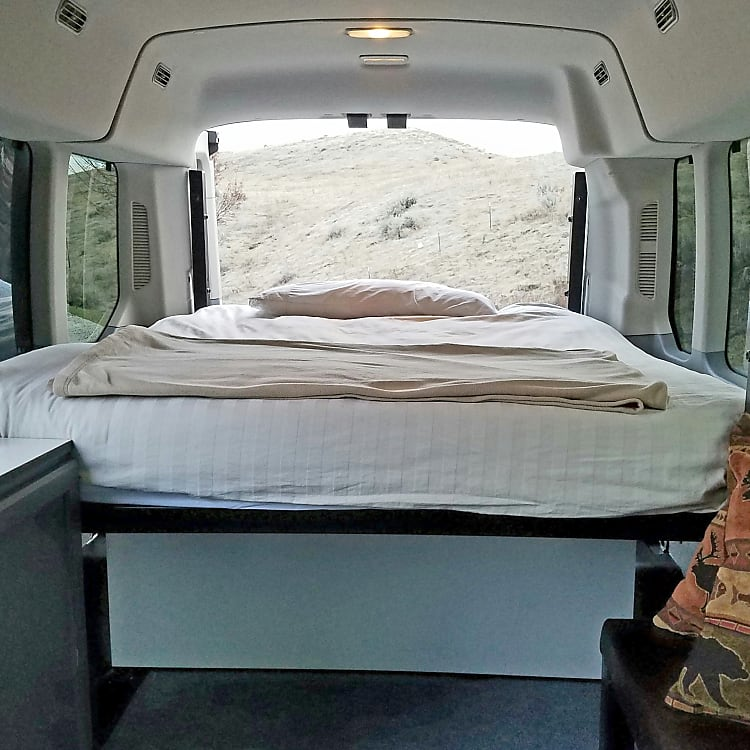 Queen Bed (Shown with deluxe bedding option)