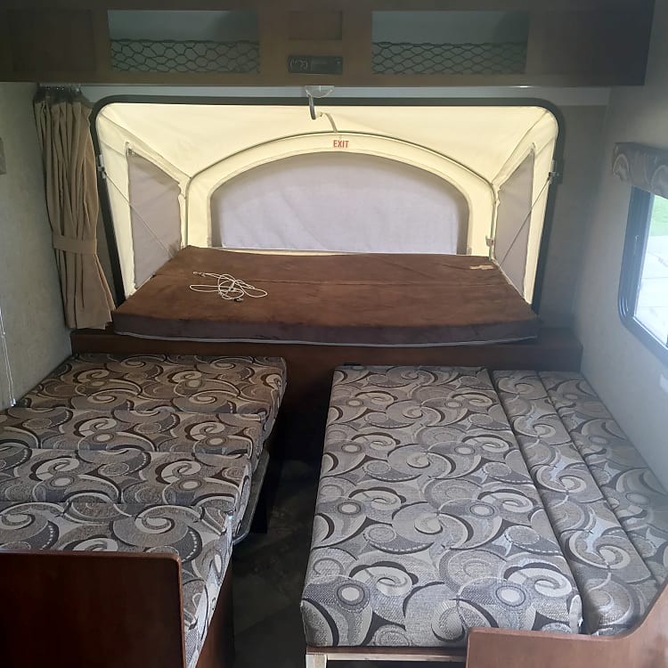 Inside with Dinning folded to bed and couch pulled out for sleeping.
