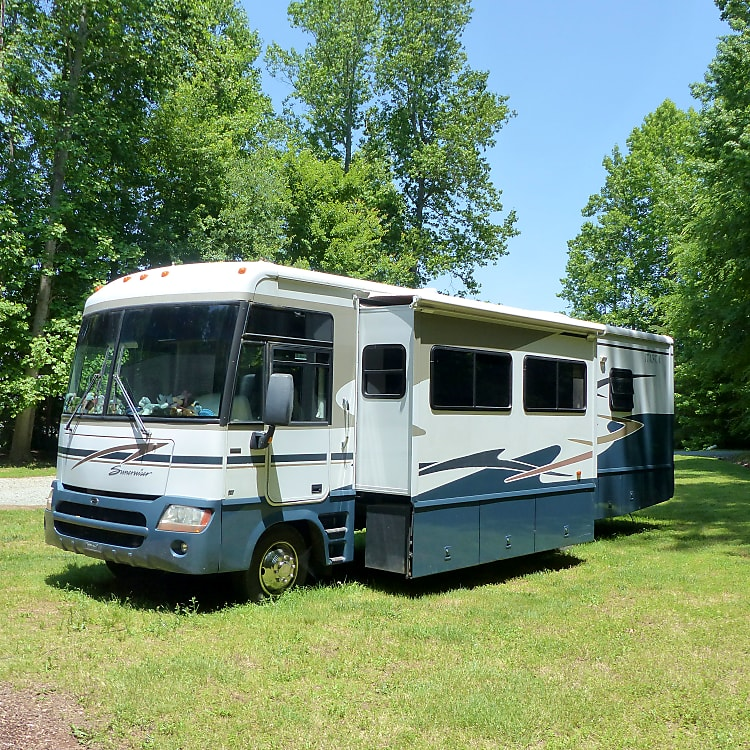 RV with Booth & Living Room slide out.  Outdoor storage is under entire slide .