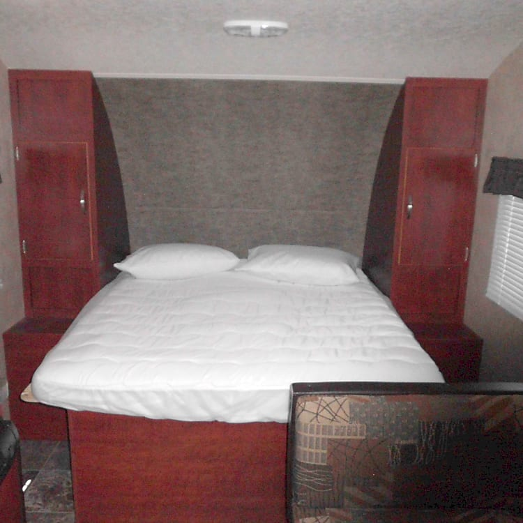Queen bed with storage closets