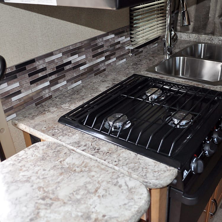 3 burner stove, double sink, oven, microwave