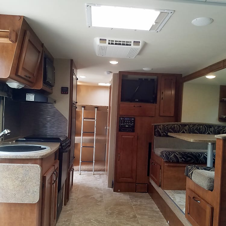 Roomy interior with the Super-slide out.  This is a stock photo but very close to the real deal.  Lance has built a high-end camper with low-VOC eco-finishes and mold-resistant materials that do not bother even the more sensitive of us.