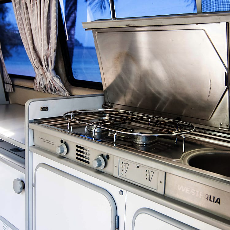 Two burner stove and sink with a pull out table to make all your cooking and dining dreams come true.