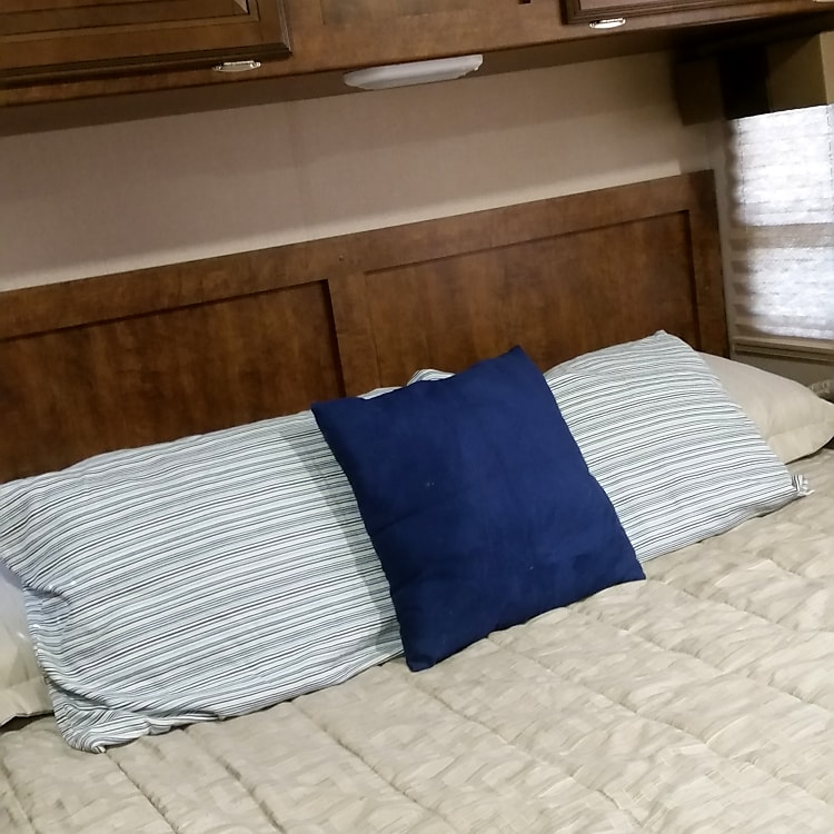 King size bed in back of RV.