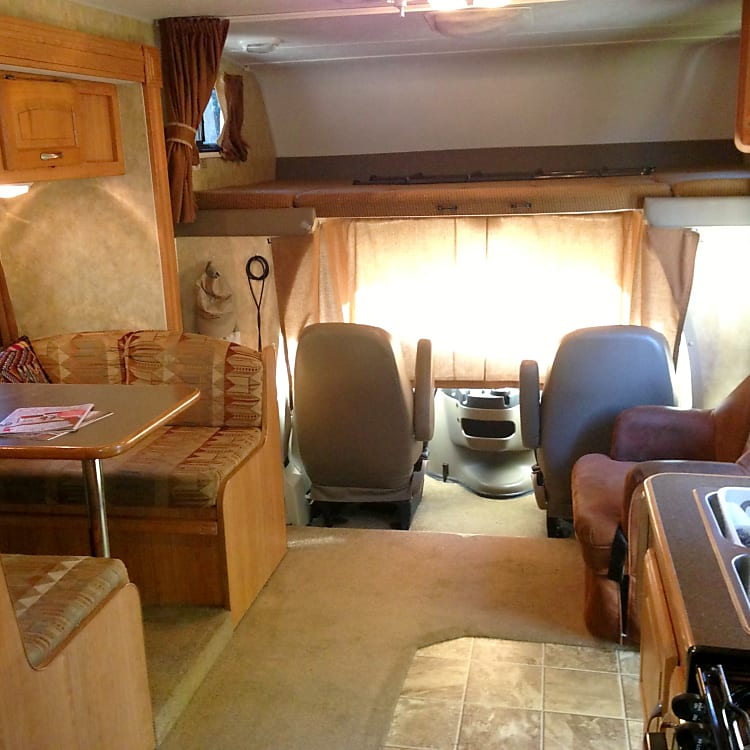 Living space with cab and bed over cab