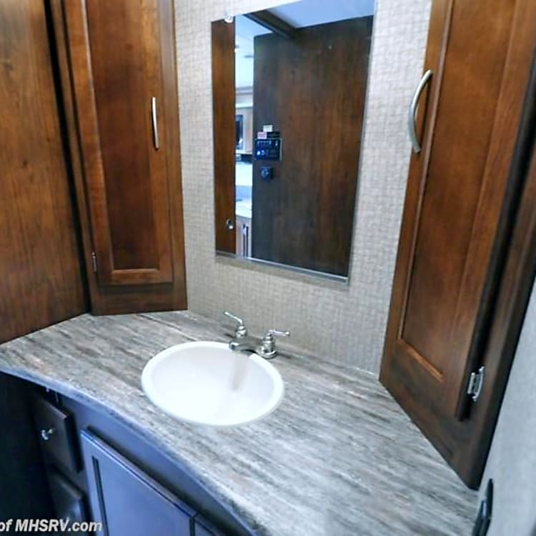 Sink in wash room is separate from toilet and shower, great for multiple use of bathroom.