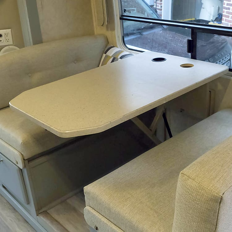 Dinette converts into a bed.