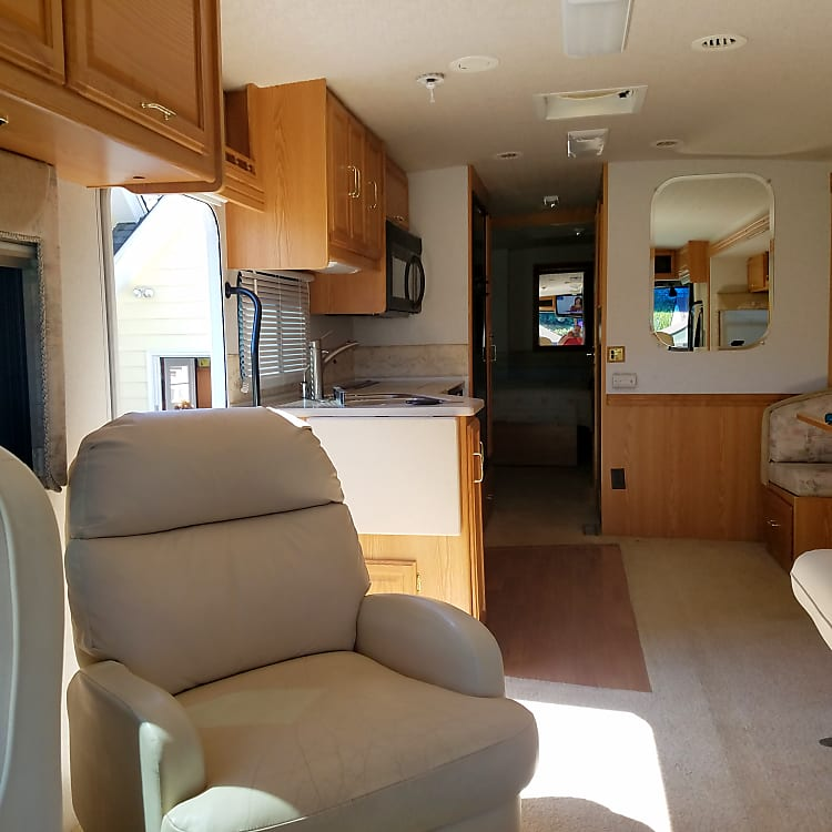 A roomy and stately interior awaits you when you reach your destination and expand the living room slide out.