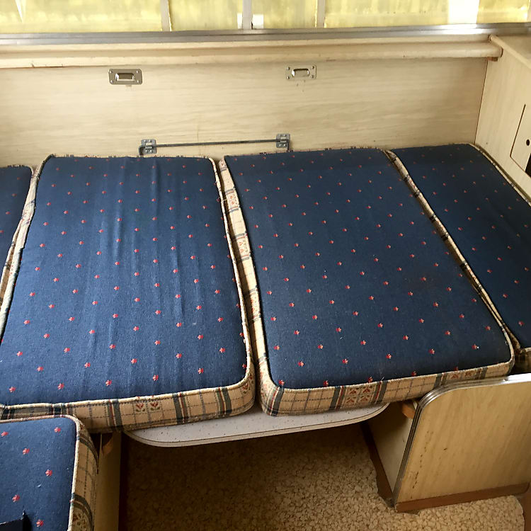 Will sleep 2 adults and 1 child in overhead bunk